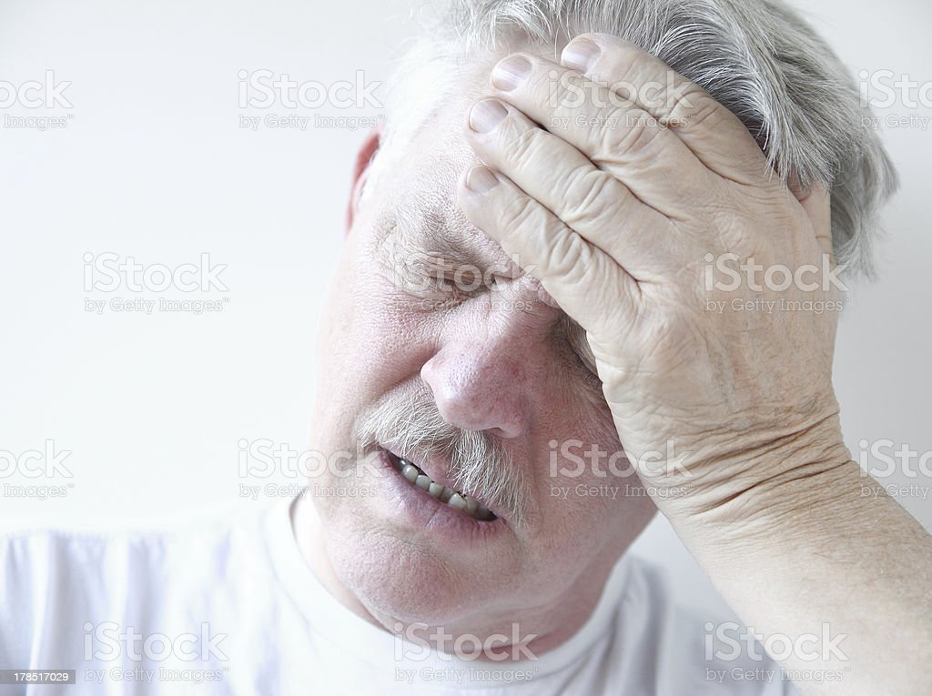 man with dizziness and head pain stock photo