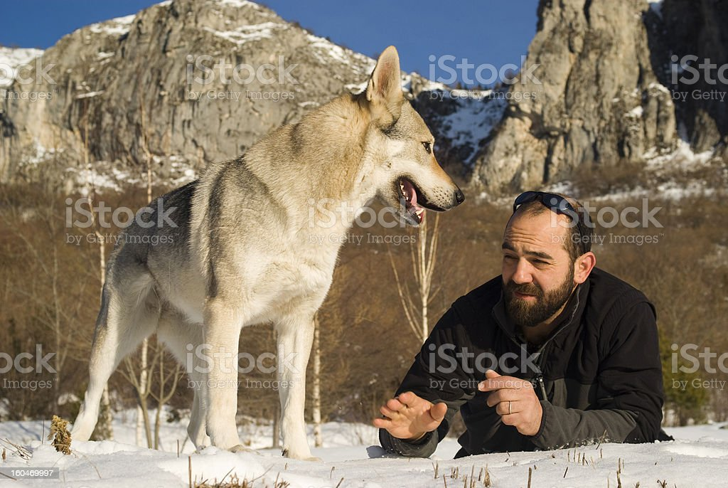 Man with dog in winter forest royalty-free stock photo