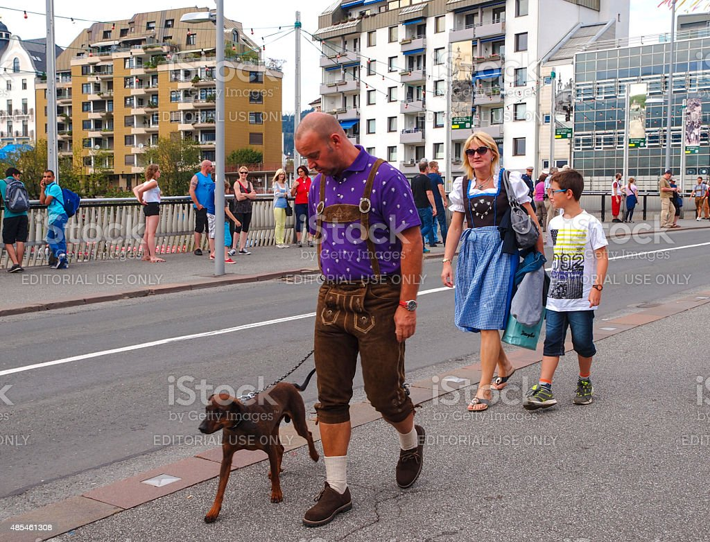 Man with dog on Villacher Kirchtag costume paradein in Austria. stock photo
