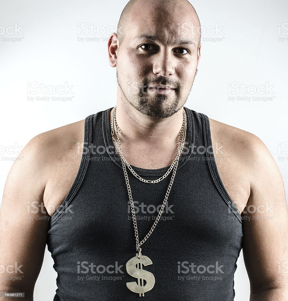 Man with dollar sign on necklace royalty-free stock photo