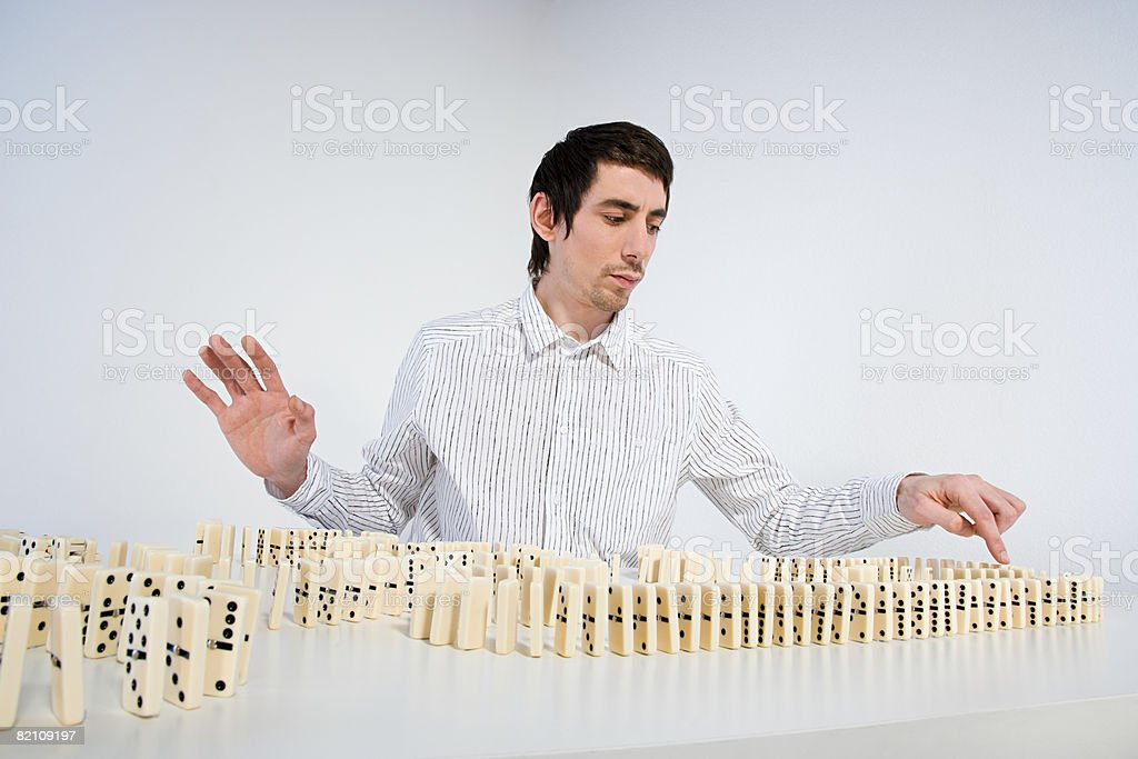 Man with dominoes royalty-free stock photo
