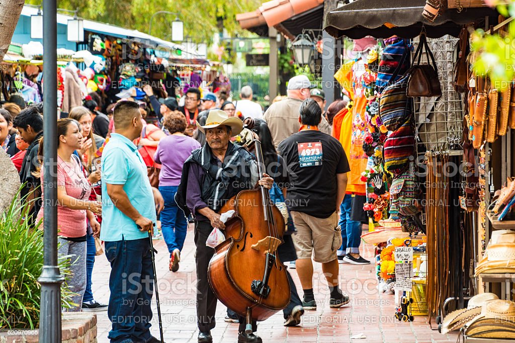 Man with double bass in El Pueblo - Los Angeles stock photo