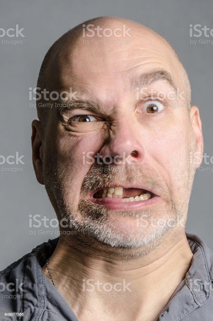 Man with double emotion: fear and anger stock photo