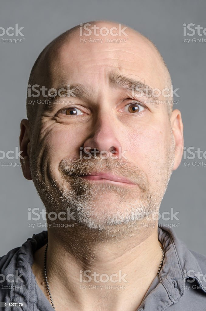 Man with double emotion: joy and sadness stock photo
