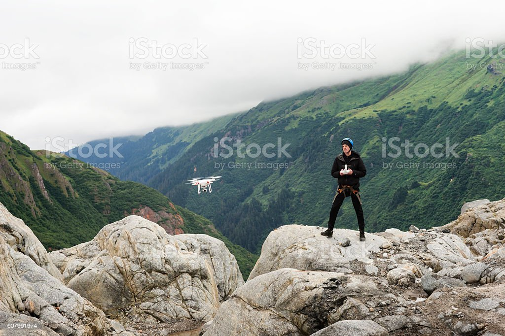 Man with drone at glacier stock photo