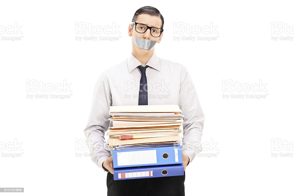 Man with duct taped mouth holding documents stock photo