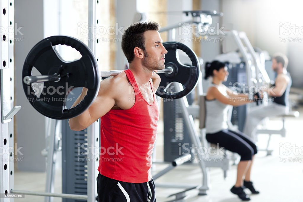 man with dumbbell weight training equipment  gym stock photo