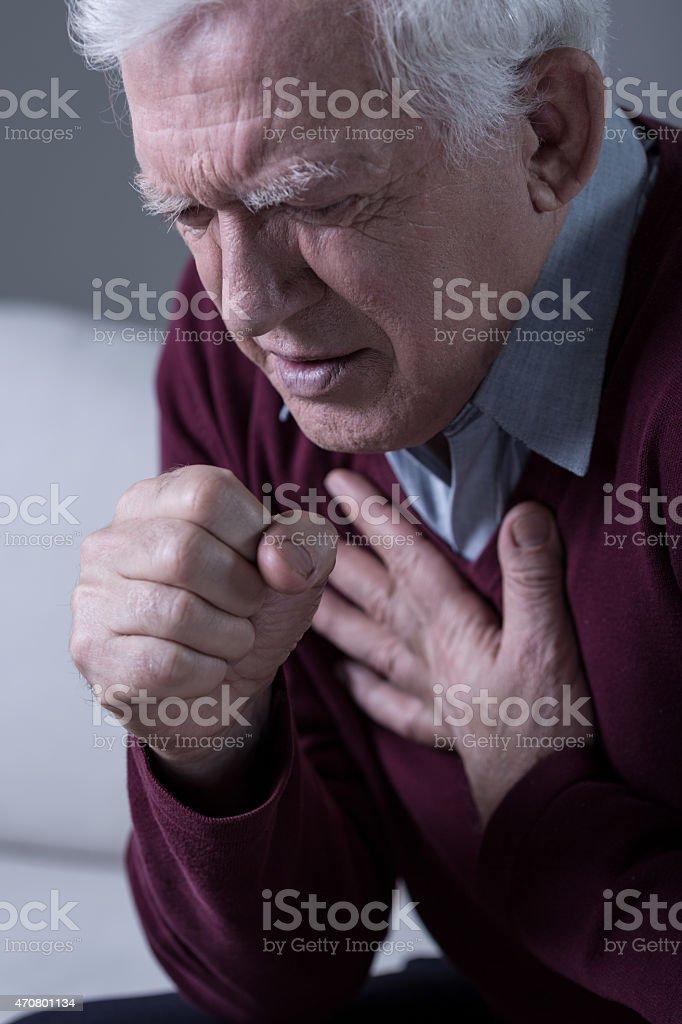 Man with dyspnoea stock photo