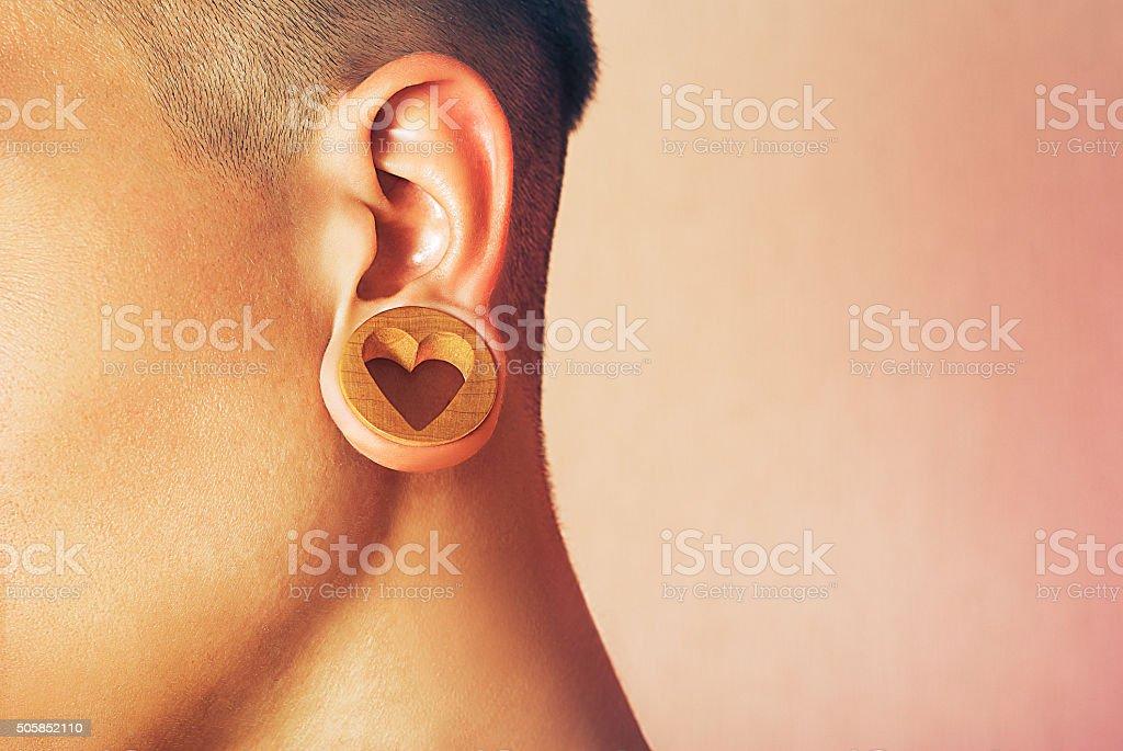 Man with earlobe hole. stock photo