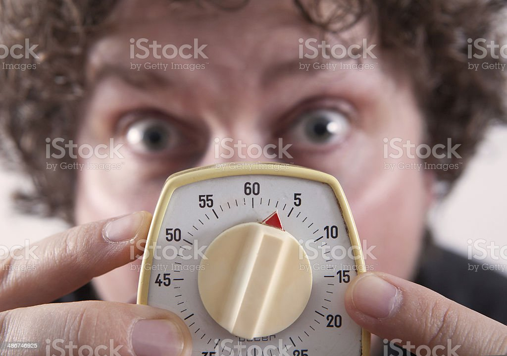 Man with Egg timer stock photo