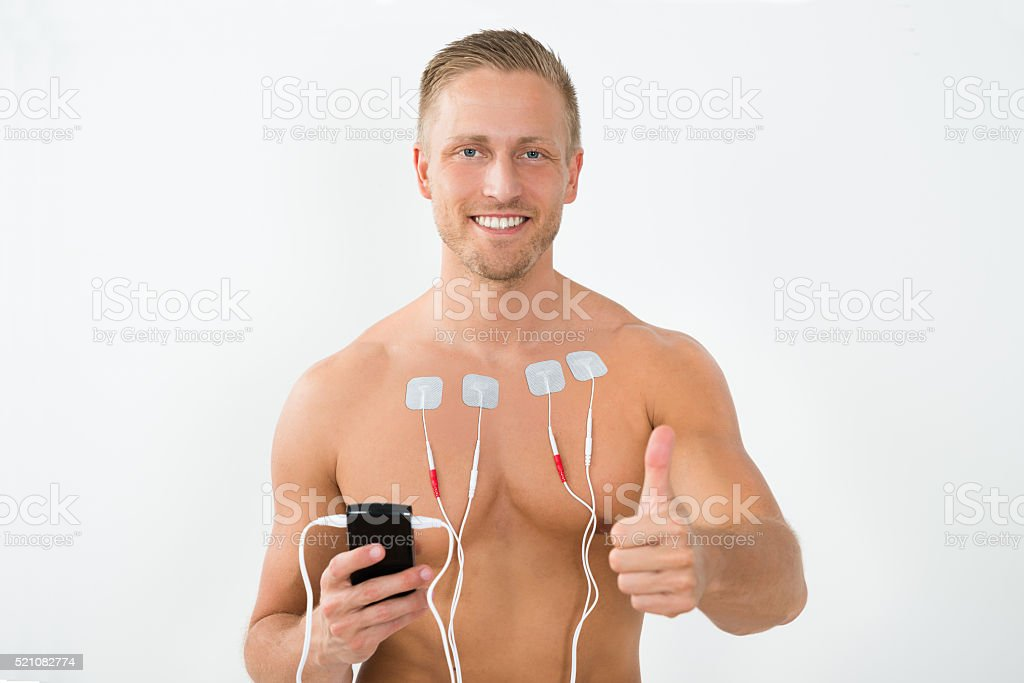 Man With Electrodes Showing Thumbs Up stock photo