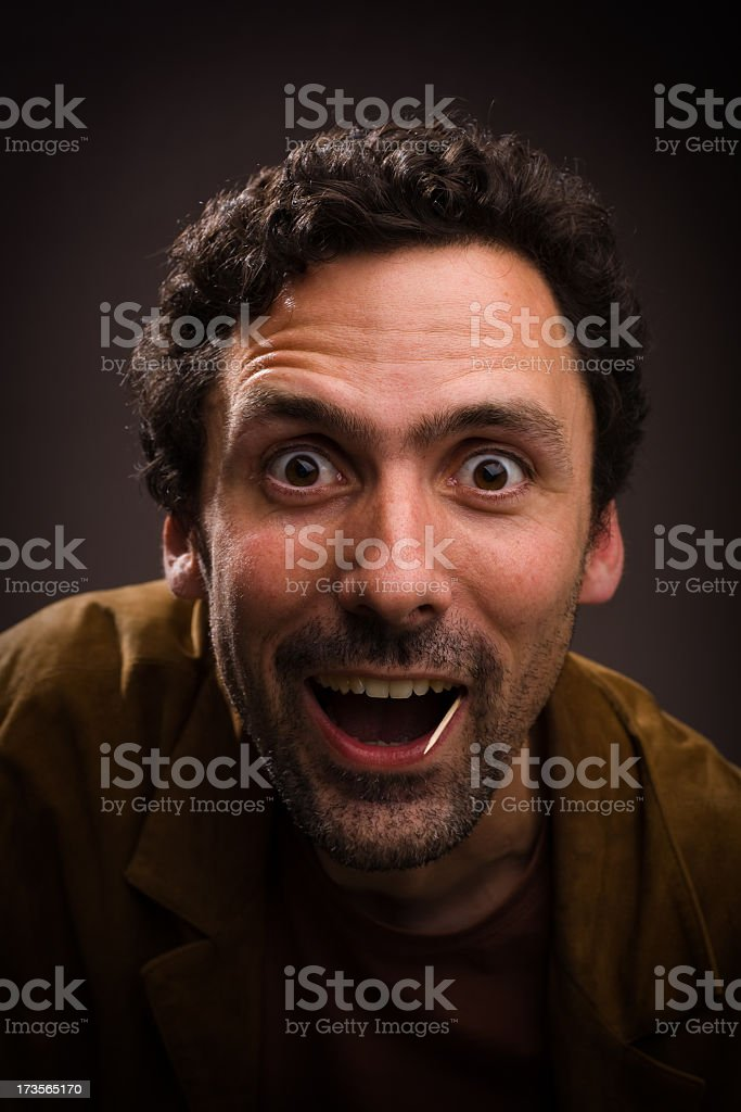 Man with energetic face and toothpick in mouth stock photo