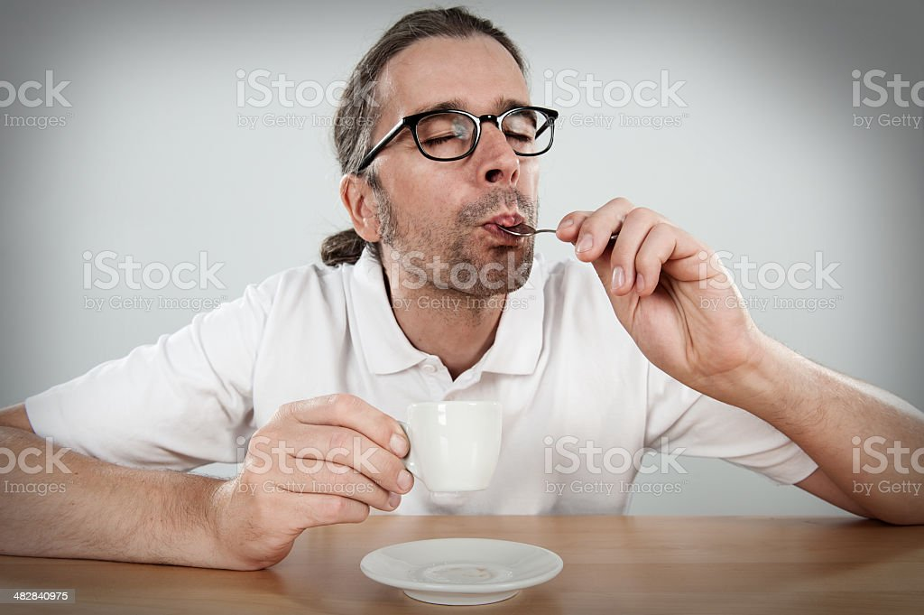 man with espresso cup stock photo