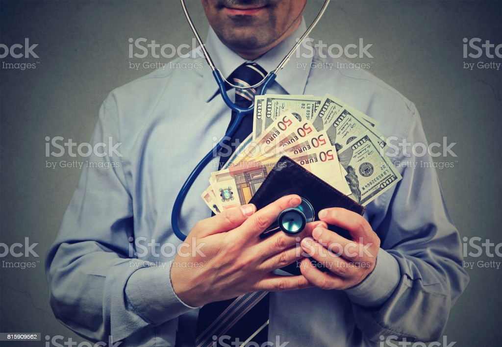 Man with euro and dollar cash in his wallet stock photo