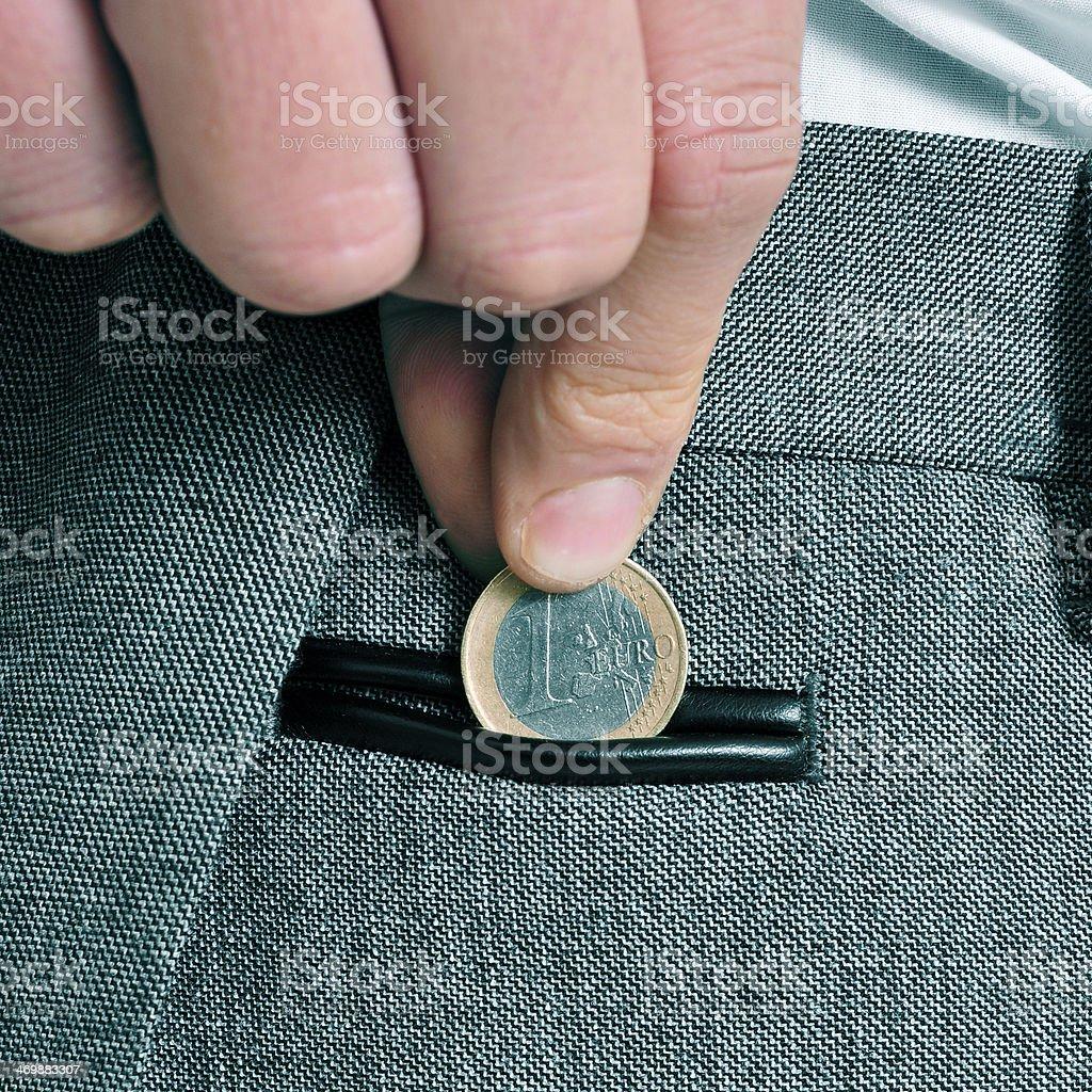 man with euro coin stock photo