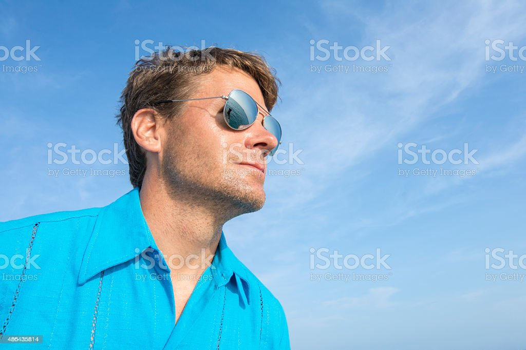 Man with eyes on the sea stock photo