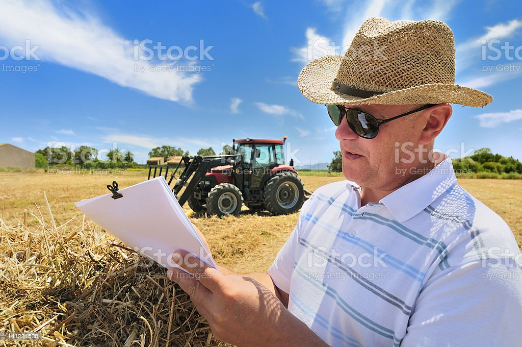 Man with Farm Paperwork royalty-free stock photo