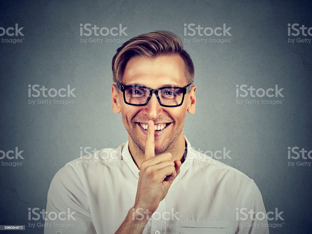 man with finger on lips Shhhh quiet, silence gesture stock photo