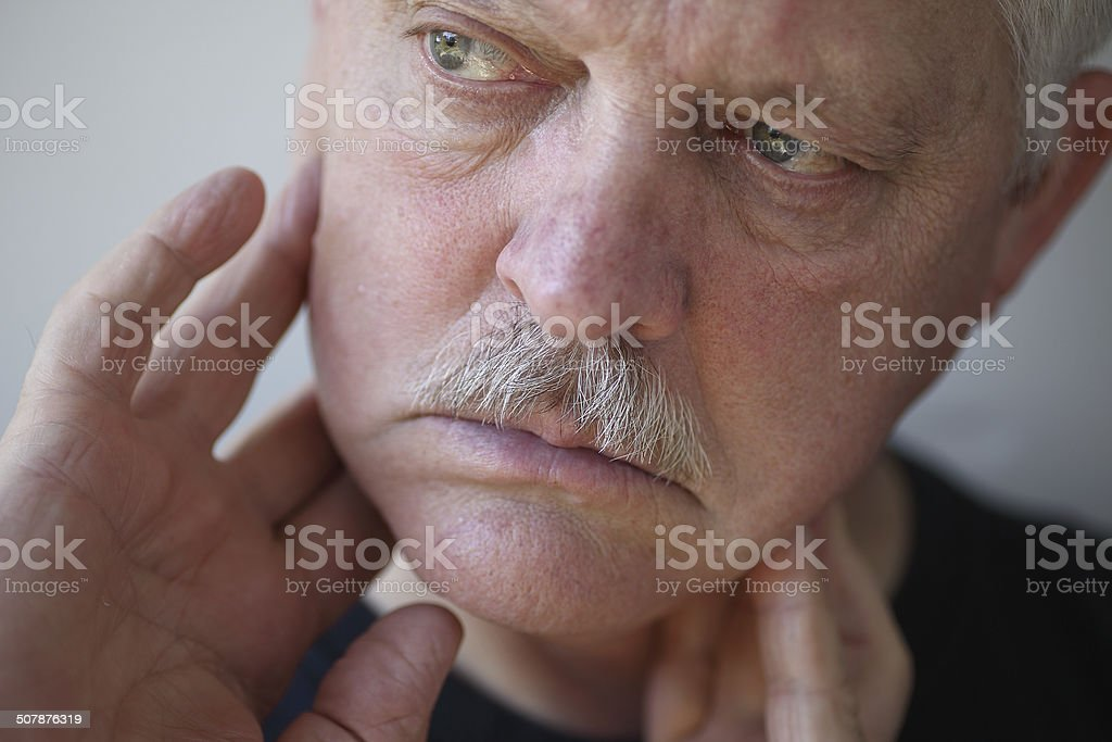 Man with fingers on painful jaw stock photo