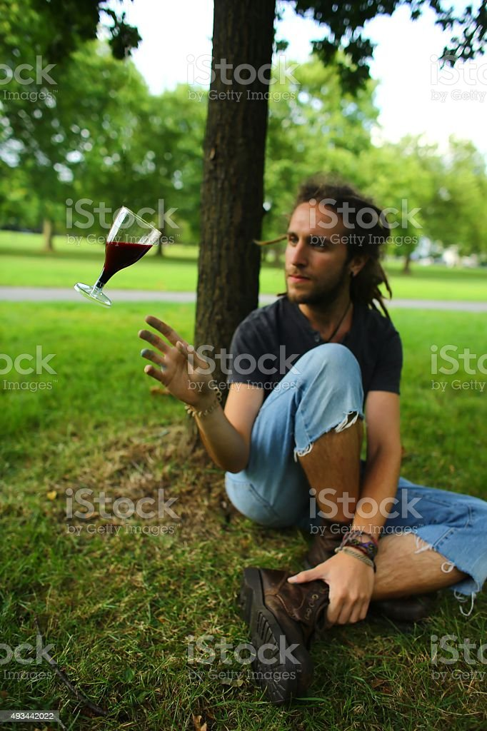Man with floating wine glass stock photo