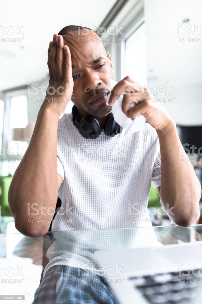 man with flu and cold at home stock photo