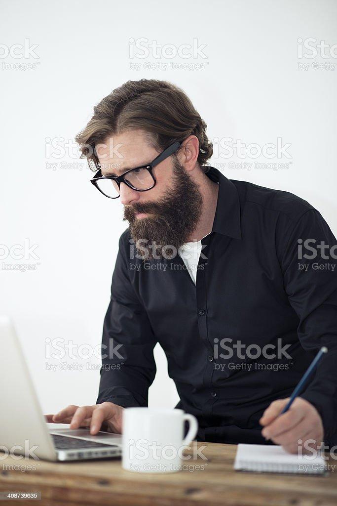 Man with full beard working royalty-free stock photo