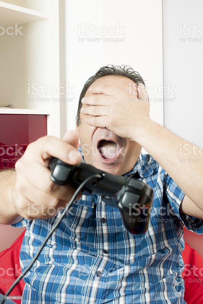 Man with gamepad stock photo