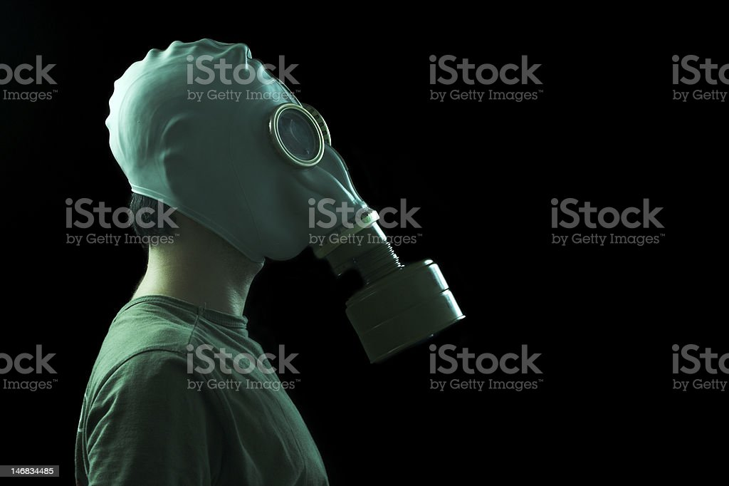 man with gas mask profile stock photo