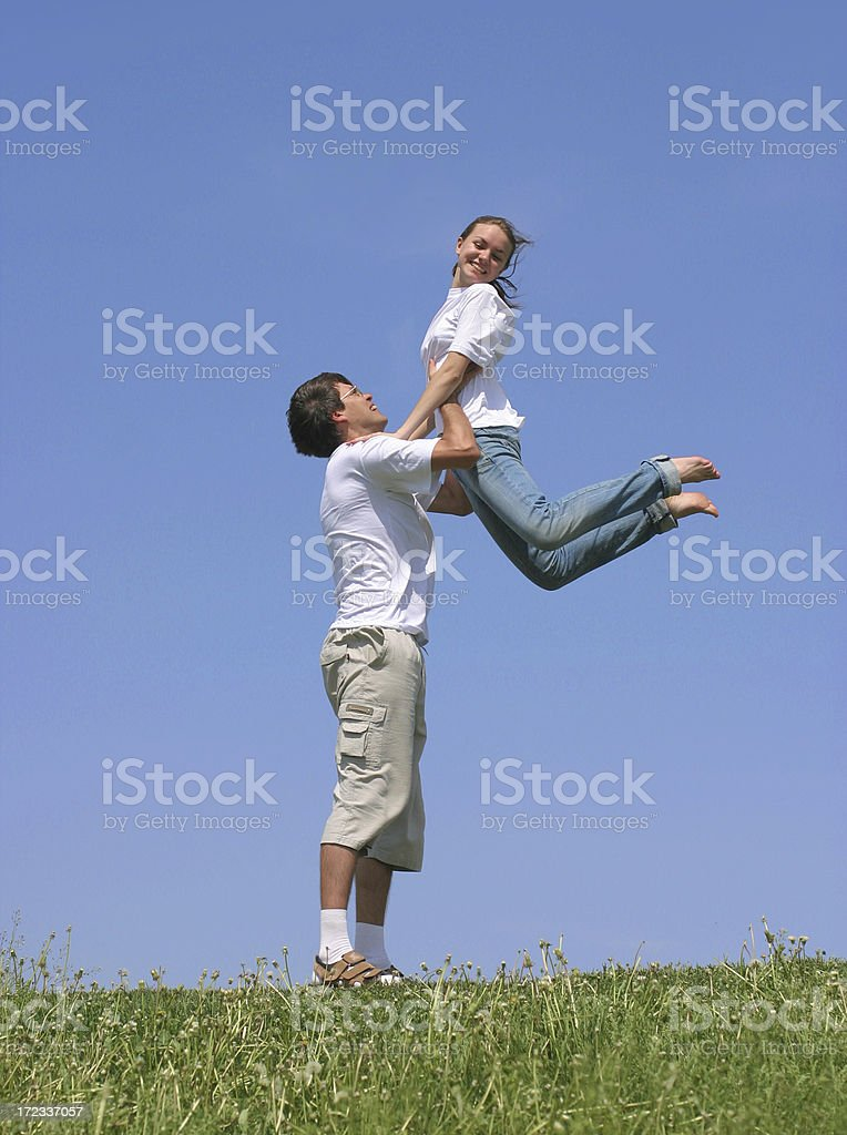 Man with girl on green meadow royalty-free stock photo