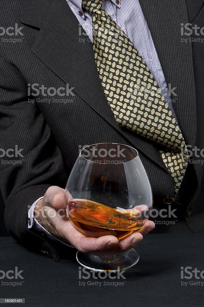 Man with glass of cognac stock photo