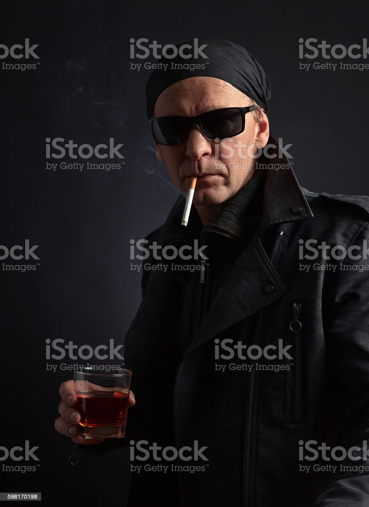man with glass of whiskey stock photo