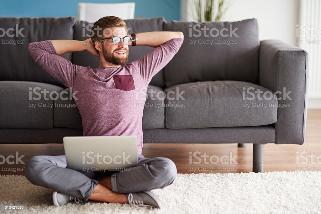 Man with good vibes sitting on the floor stock photo