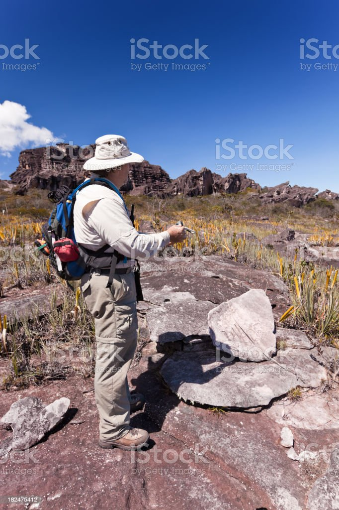 Man with GPS measuring coordinates royalty-free stock photo