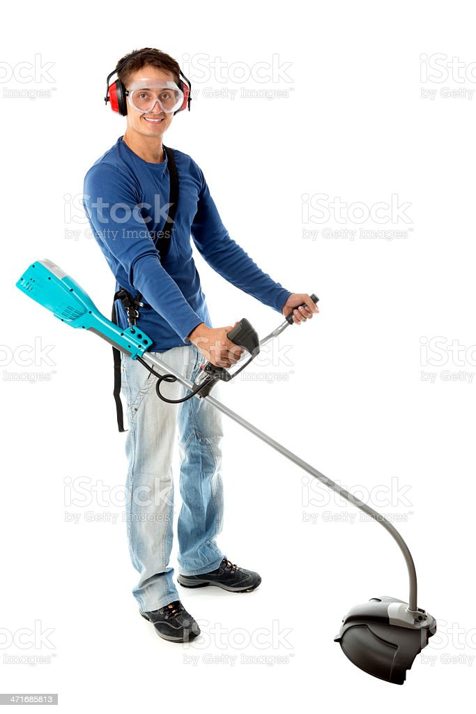 Man with Grass Trimmer royalty-free stock photo