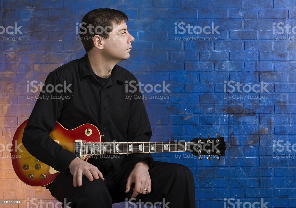Man with Guitar on Lap royalty-free stock photo
