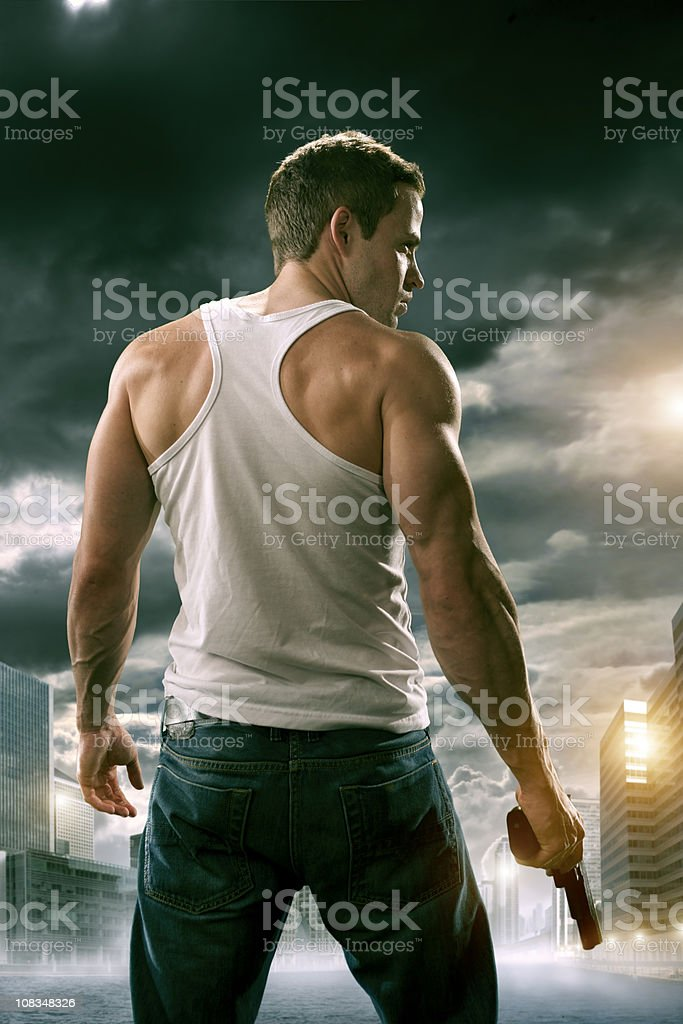 man with gun in city stock photo