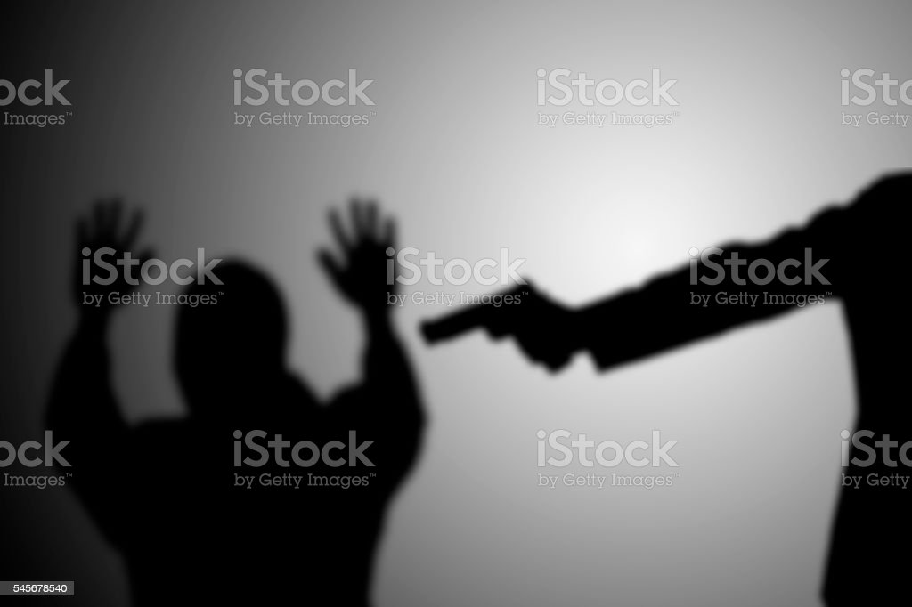 Man with gun point to victim's head stock photo
