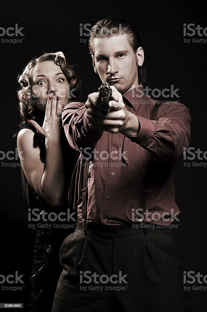 man with gun protecting his woman royalty-free stock photo