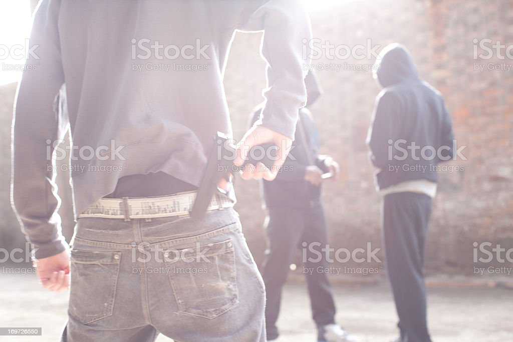 Man with gun robbing drug dealers royalty-free stock photo