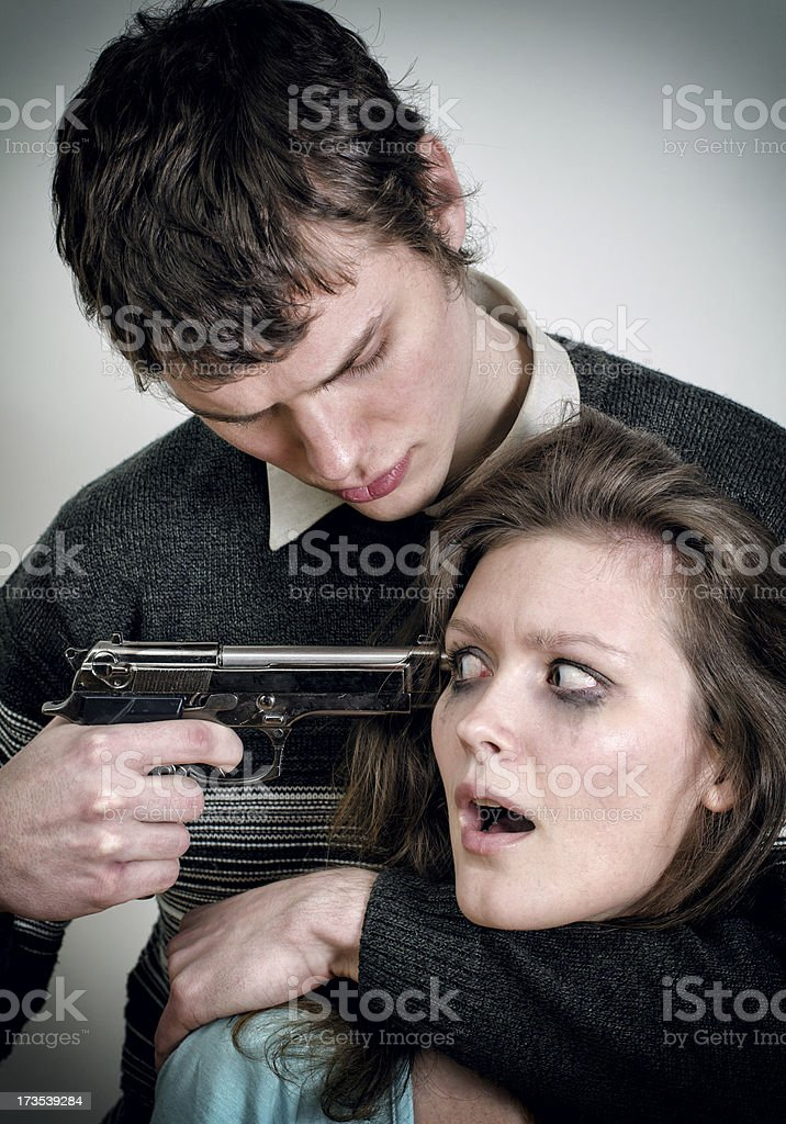 Man with gun threaten woman royalty-free stock photo