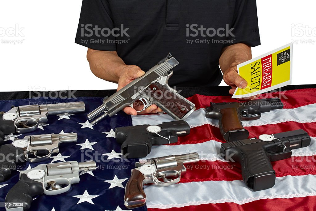 Man with guns For Sale Safety Brochure American USA Flag stock photo