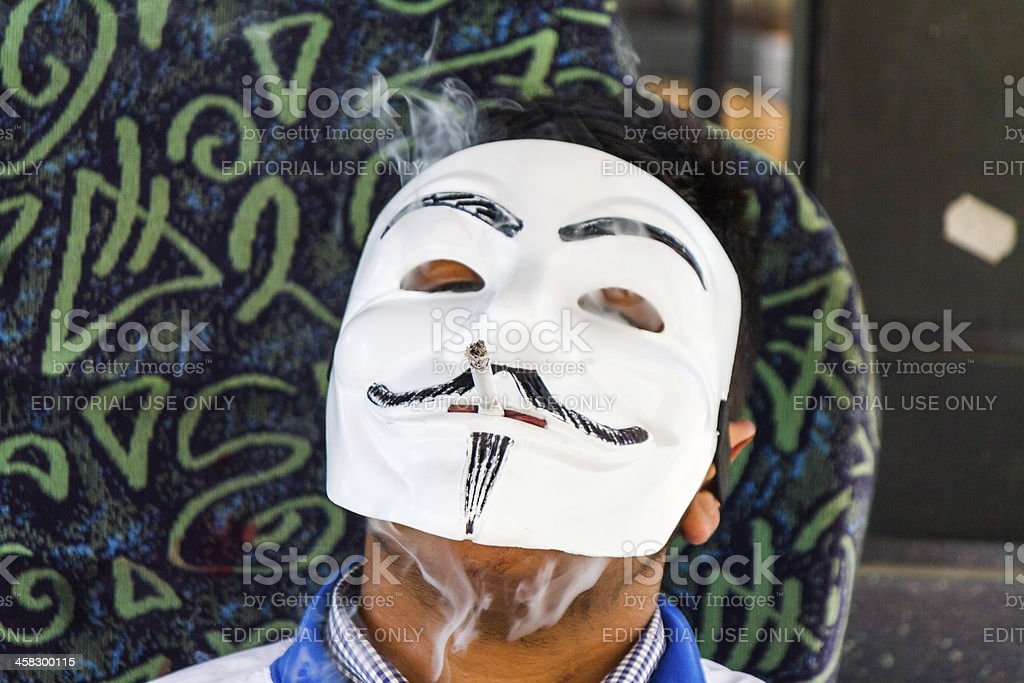 Man with Guy Fawkes stock photo
