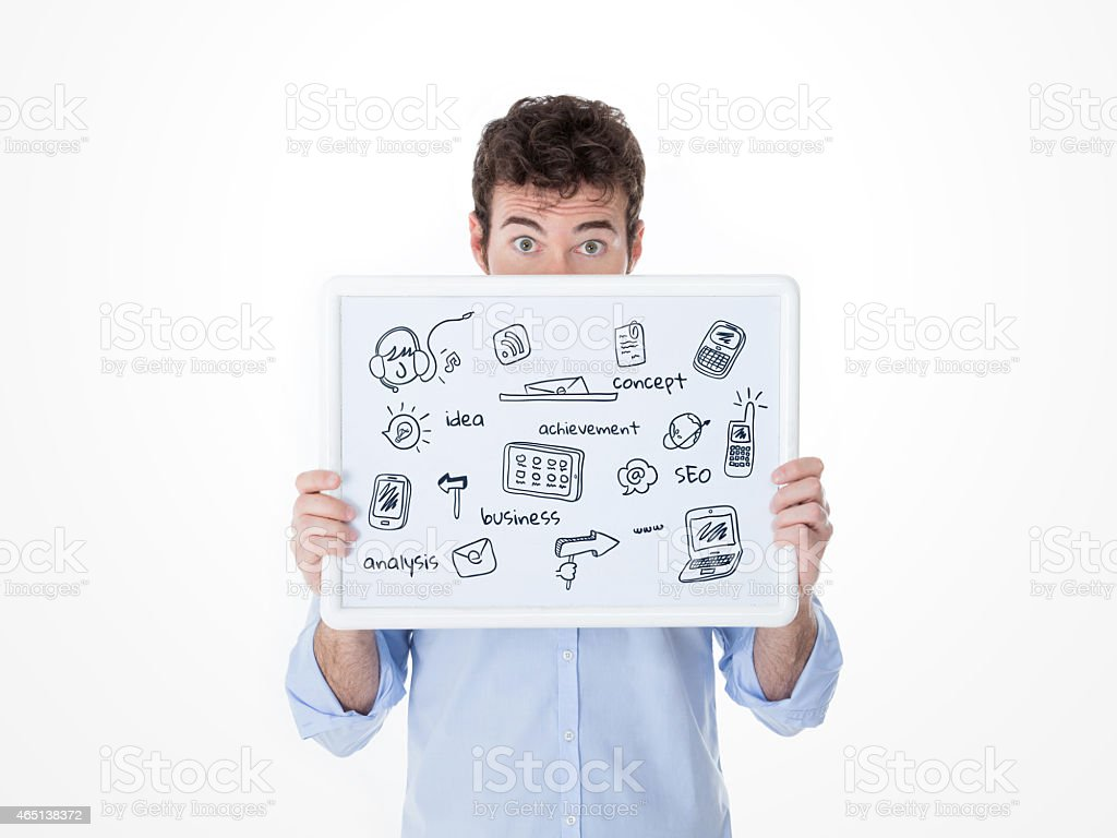 man with half face behind a board with technologic sketches stock photo