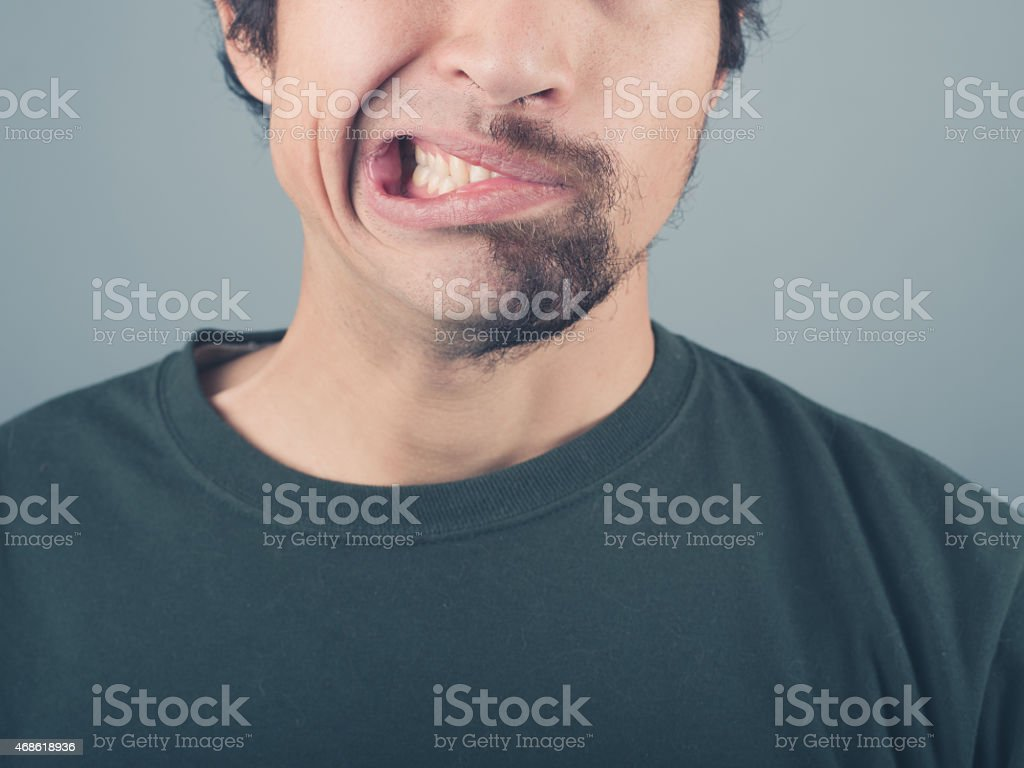 Man with half shaved beard stock photo