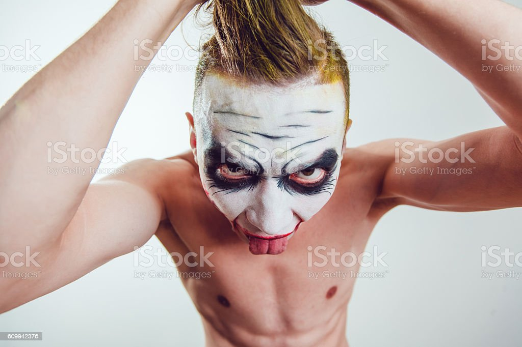 Man with Halloween face art on white background stock photo