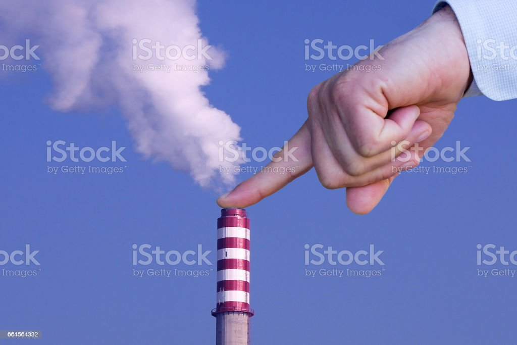 Man with hand making stop to pollution stock photo