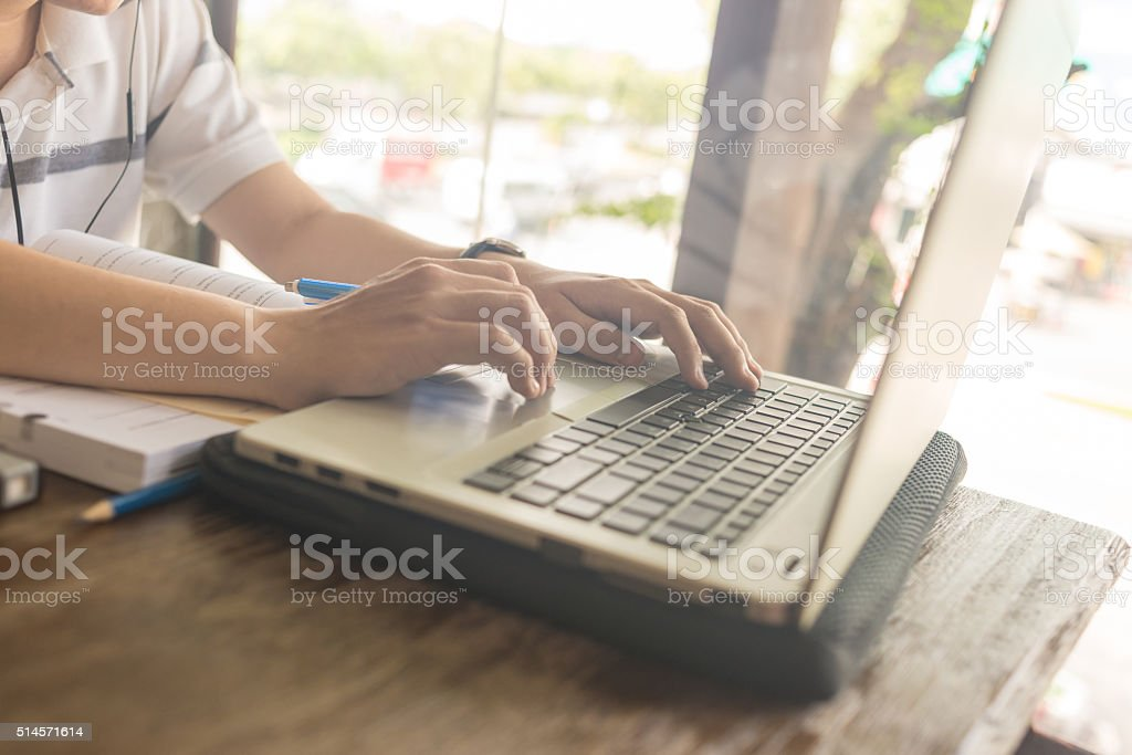 Man with hand on laptop computer stock photo