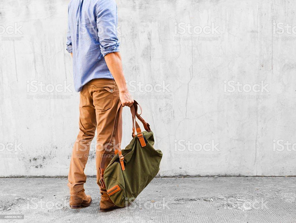 Man with handbag stock photo