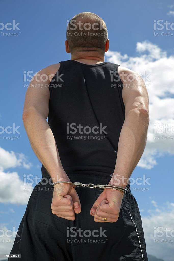 man with handcuffs royalty-free stock photo