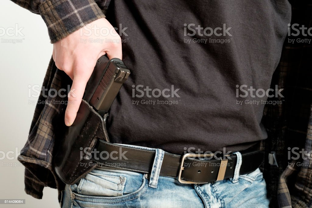 Man with Handgun in Holster stock photo
